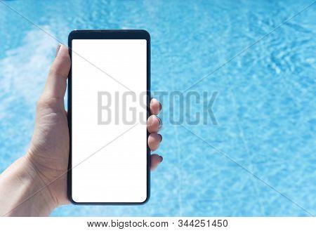 Woman Hand Using Smart Phone Near Swiming Pool
