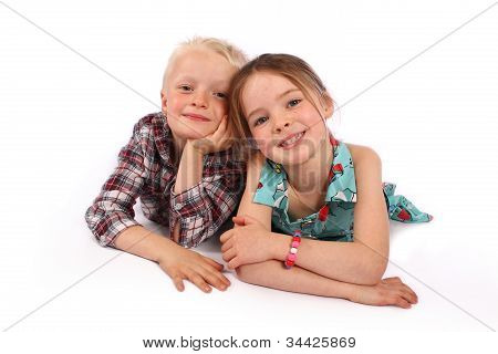 Children Smiling Whilst Lying Down.