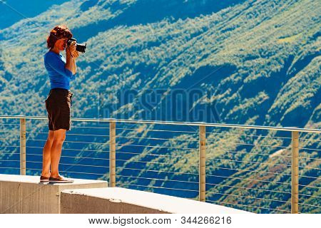 Female Tourist With Camera Taking Travel Picture, Enjoying Mountains Landscape From Ornesvingen View