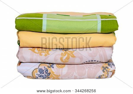 Bed Linen Isolated. Close-up Of A Stack Or Pile Of Colorful Folded Bed Linen Or Duvet Covers Isolate