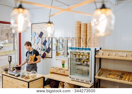 Startup Small Business People And Service Concept. Happy Male Small Business Owner Stands At Counter