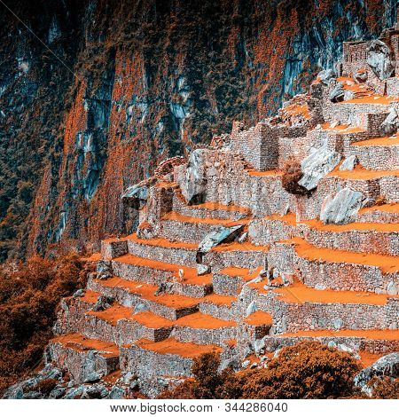 Amazing scenery of majestic ancient stone Machu Picchu temple covered with grass on the background of rocky mountain