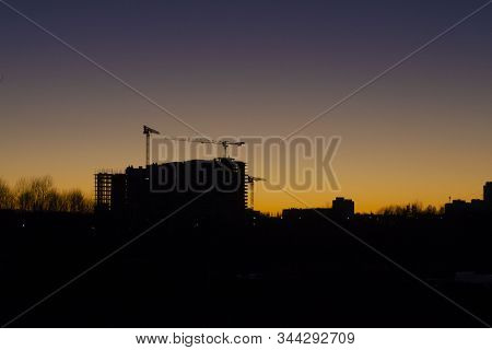 Construction Site. Construction Of A Buiding With A Crane. Silhouette Of Buiding