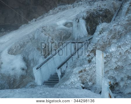 Completely Frozen Stairs With Thick Icicle Near Seljalandsfoss Waterfall In Iceland. Cloudy Day, Sno