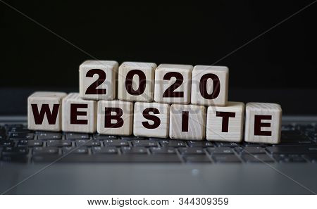 Concept Word Internet Site On Wooden Cubes On The Background Of A Laptop