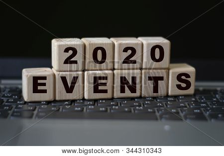 Concept Word Events On Wooden Cubes On The Background Of A Laptop