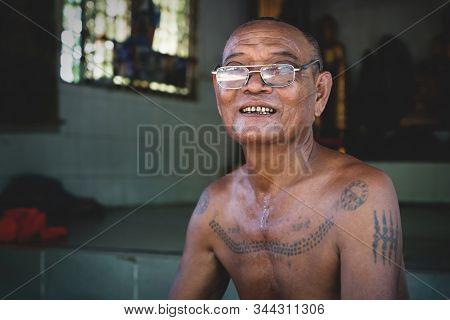 Sangkat Krabei Riel, Siem Reap Province, Cambodia - 4 April 2013: Cambodian Buddhist Monk With Tatoo