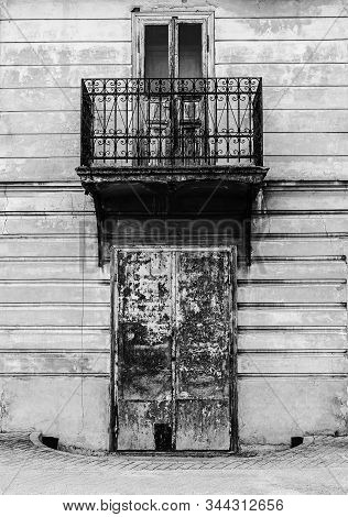 Old Vintage Building With Metal Balcony, Symbolizing Lonliness.