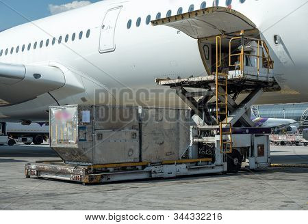 Air Cargo Logistic Containers Are Loading To An Airplane.transportation And Aerospace Industry Deliv