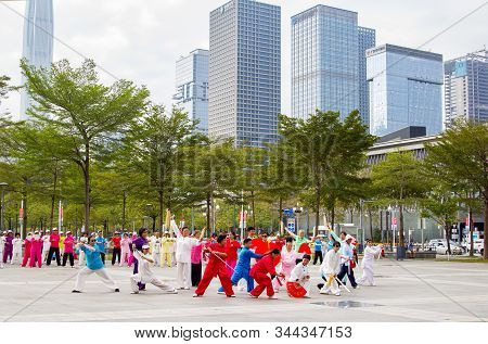 Shenzhen, China - November 14, 2015: A Group Of Retired People Are Practicing Martial Art Dance In S