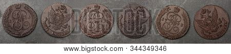 Numismatics. Old Collectible Coins Made Copper On A Wooden Table. Top View. Black Backgraund. Banner