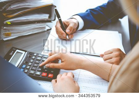 Bookkeeper Or Financial Inspector And Secretary Making Report, Calculating Or Checking Balance. Inte