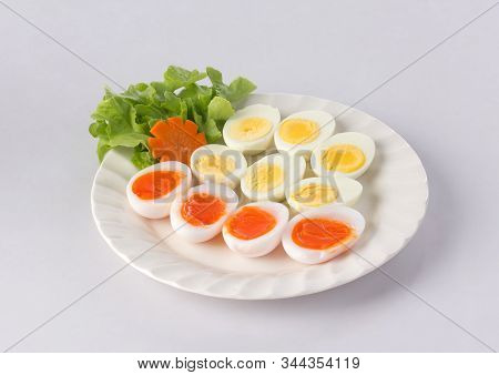 Soft Boiled Duck Eggs And Hard Boiled Eggs On The Dish Isolated On White Background
