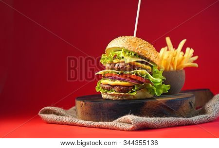 Tasty Burger With Double Beef And French Fries. Copy Space.