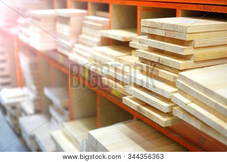 Shelves With Lumber And Wooden Boards. Building Warehouse.