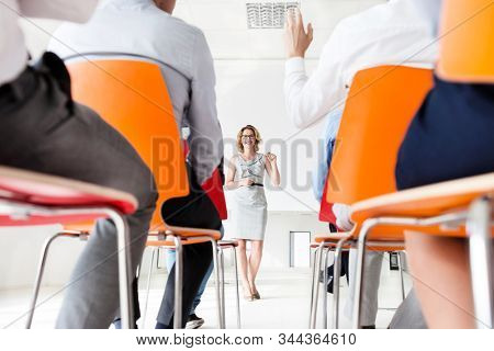 Businessman discussing plans with business people in conference room