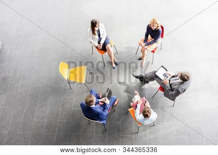 Business people on meeting in new office