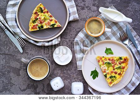 Open Savory Shortcrust Pastry Pie With Ham, Broccoli And Egg Filling On A Gray Concrete Background.