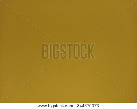 Ocher Background. A Dist Of Colored Paper. Can Use As Background