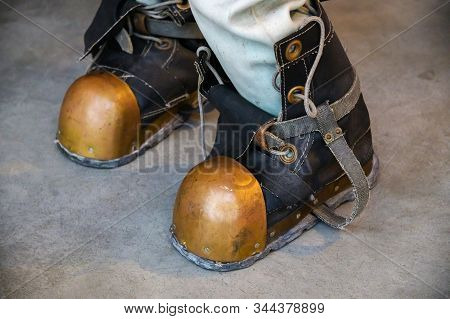 Close-up Shoes Of An Old Vintage Three-bolt Deep-sea Diving Suit. Suit For Deep Sea Diving Of The La