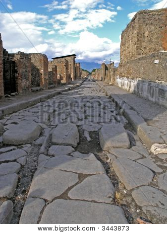 Street In Pompei With Old Roman Cart Track