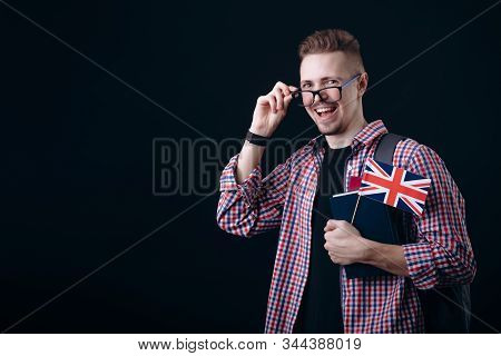 Youngster With British Flag And Books Adjusting Glasses