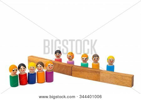 A Team Of Wooden Toys  Are Separated By A High Wall. The Image Of The Separation Of Families By Dict