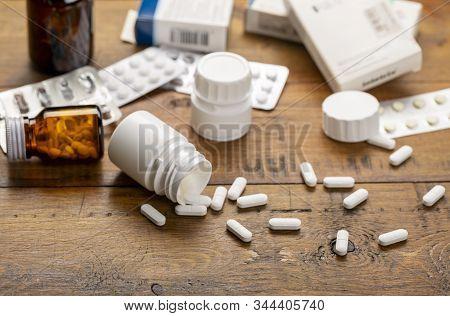 Pills White, Blister Pack And Different Medicine Bottles