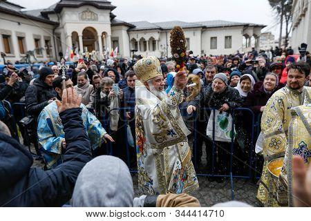 Bucharest, Romania - January 6, 2020: Romanian Orthodox Patriarch Daniel Sprinkles Holy Water Over B