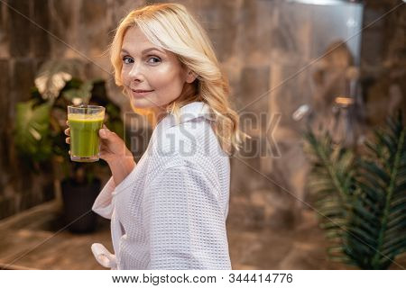 Female With A Glass Of Vegetable Beverage