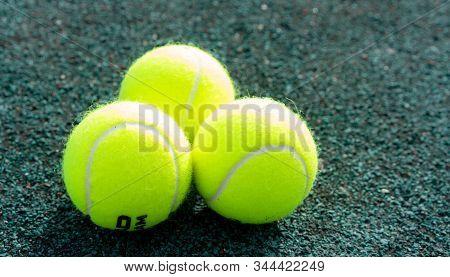 Tennis Balls On The Tennis Court.tennis Balls On The Tennis Court