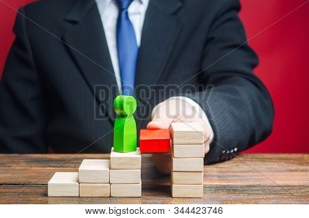 A Businessman Raises An Employee Up The Career Ladder. Appointment Of An Employee To A Next Position
