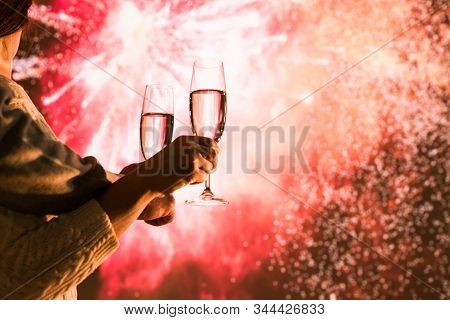 Merry Man And Woman Toasting With Glasses Champagne Celebrate Holiday Christmas Or New Year During C