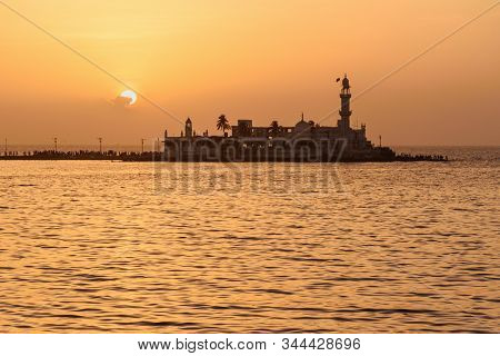 Haji Ali Dargah Mosque And Tomb On Islet Off The Coast Of Worli On Sunset. Mumbai. India