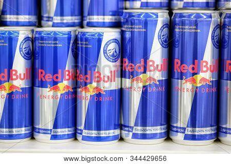 Kharkiv, Ukraine December 1, 2019: Red Bull Classic Energy Drink Cans. Red Bull Austrian Energy Drin