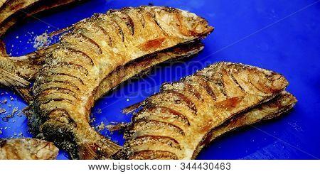 Dried Salted Fish Dried On Market.blue Background.dry Fish Market.golden View Of Salted Dry Fish.dri