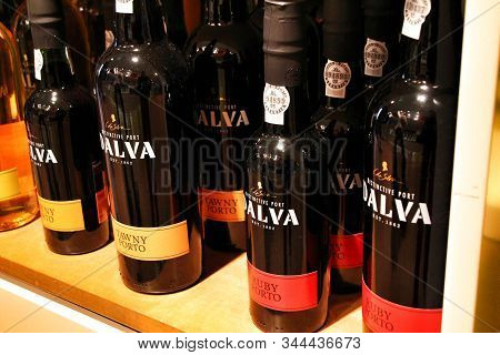 Porto, Portugal- January 6, 2020: Different Types Of Port Wine Bottles For Sale In A Port Winery