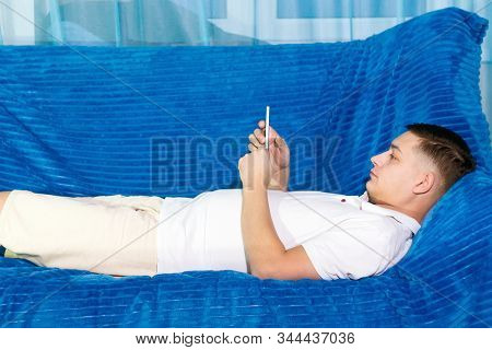 Attractive Young Male Dressed In White T-shirt Chatting With Girlfriend Online Via Social Network, M