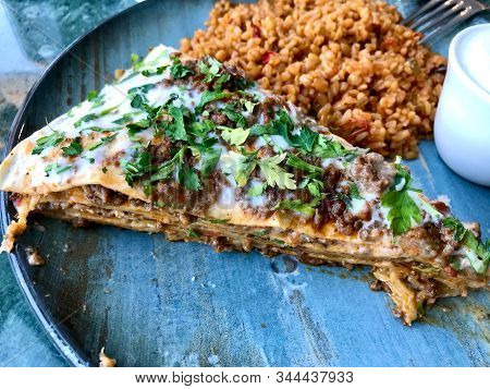 Turkish Kayseri Food Yaglama Layers Of Flat Bread With Ground Meat, Yogurt And Bulgur / Bulghur Rice