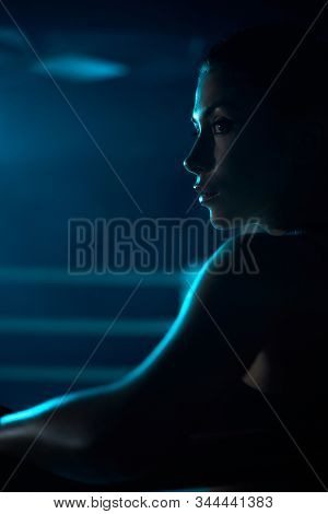 Close Up Of Serious Young Professional Female Kickboxer Wearing Sports Outfit And Looking Away. Figh