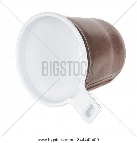 Lying Unused Disposable White Plastic Mug With Brown Satin Texture On The Outside Isolated On White