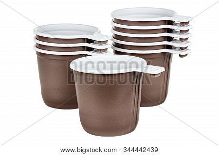 Standing One, Three And Five Unused Disposable White Plastic Mugs With Brown Satin Texture On The Ou