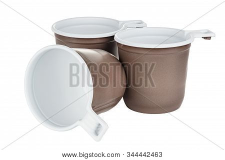 Standing Two Unused Disposable White Plastic Mugs With Brown Satin Texture On The Outside And One Ly