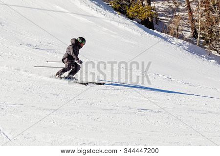 Pyrenees, Andorra - February 17, 2019: A Skier Descends From The Mountain At High Speed At A Ski Res