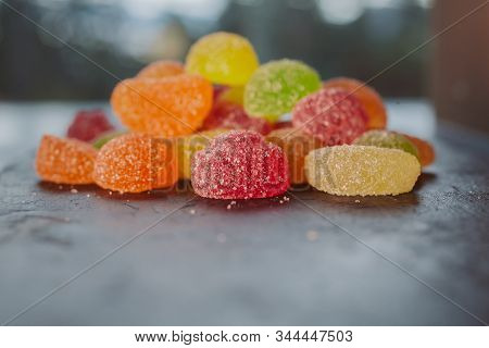 Heap Of Colorful Jelly Sugary Candies As Background. Colorful Jelly Candies With Sugar. Close Up Vie