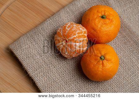 Mandarin And Slices Of Citrus On A Wood Desk. Orange Mandarin Or Tangerine Natural Fruit