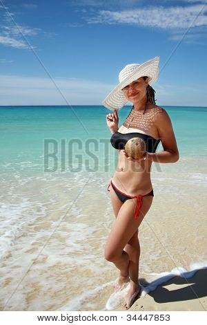 Woman Holding Coconut In Hand