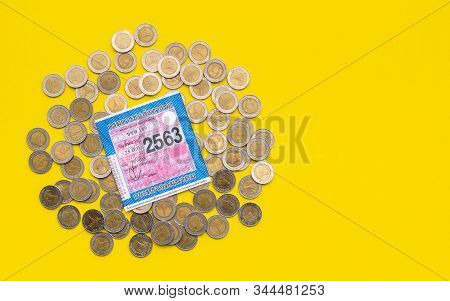 Sukhothai, Thailand - December 12, 2019 : Top View Of Coin And Car Tax Sticker Issued By Thai Depart