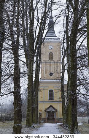 Old Evangelical Church Of The Holy Trinity Outside Surrounded By Old Trees At Winter , Village Smrec