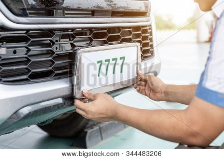Technician Changing Car Plate Number In Service Center